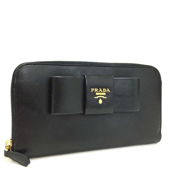 05403c9d8497 100% Authentic Prada Saffiano Ribbon Zip Wallet. M_5ac00cc9a4c4857514540cf3